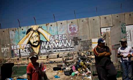 Graffiti of jailed Palestinian Fatah leader Marwan Barghouti in the West Bank town of Kalandia.