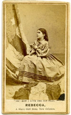 "A carte de visite with the words ""Oh! How I Love the Old Flag!"" Rebecca, A Slave Girl from New Orleans, 1864."
