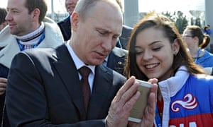 Vladimir Putin looks at a mobile