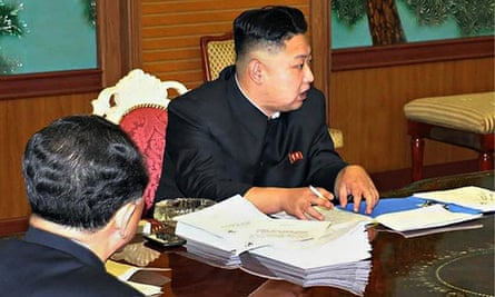 Kim Jong-un with phone