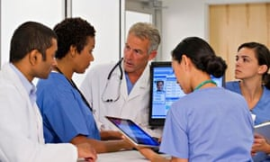 Doctors using computer together in hospital
