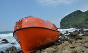 A lifeboat that washed up on central Java's Karangjambe Beach after hitting coral and rocks.