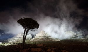 The lights shine on Table Mountain just before being turned off for the global Earth Hour, in Cape Town, which has been voted as the 2014 Global Earth Hour capital.