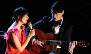 Karen O and Ezra Koenig perform onstage during the Oscars