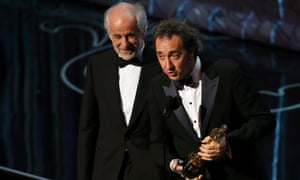 Director Paolo Sorrentino actor and Tony Servillo accept the Oscar for best foreign language film