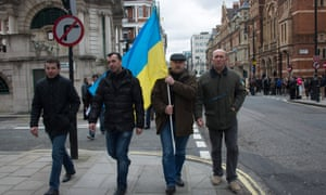 Ukrainians in London march to the US embassy to urge American help in avoiding a Russian invasion.