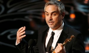 Alfonso Cuarón with his Oscar for best director