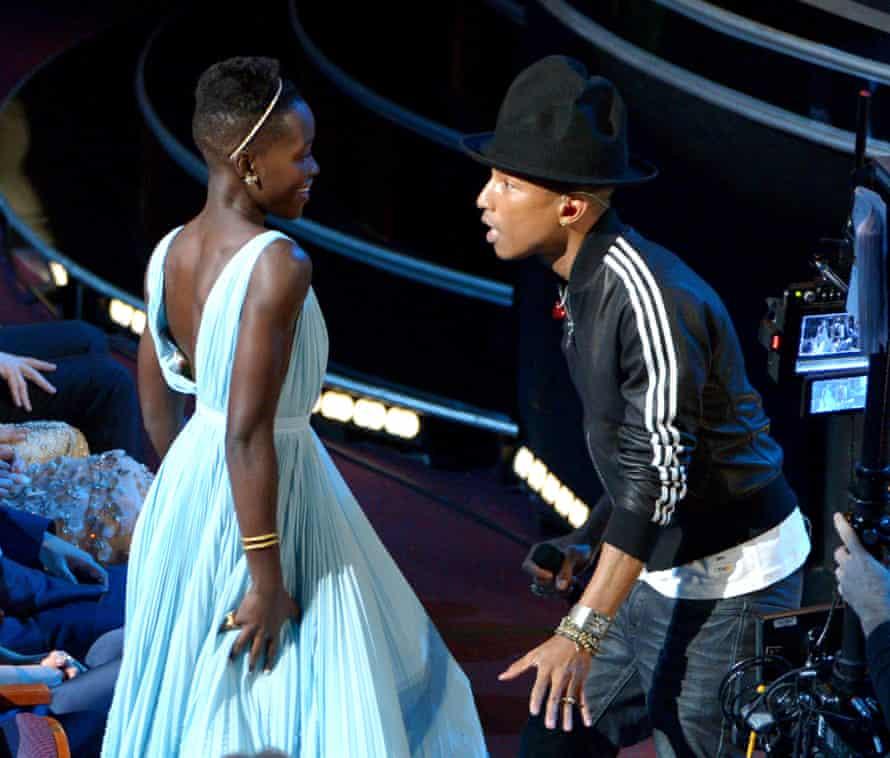 Lupita Nyong'o and Pharrell Williams.