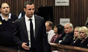 Oscar Pistorius arrives in court ahead of his trial in Pretoria