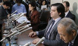 Mt. Gox CEO Mark Karpeles, sitting at second right,  attends a press conference at the Justice Ministry in Tokyo, where he apologised for his company's collapse.