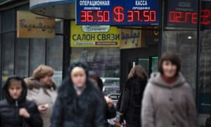 People walk past a currency exchange office in downtown Moscow, Russia, Monday, March 3, 2014.