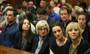 Members of Oscar Pistorius's family await the start of the first day's proceedings inside the high court in Pretoria