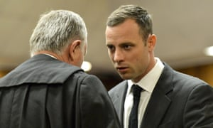 Oscar Pistorius talks with his lawyer Barry Roux