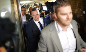Oscar Pistorius leaves the High Court after the first day of his murder trial in Pretoria.