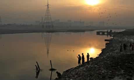 Men on banks of Yamuna River Delhi