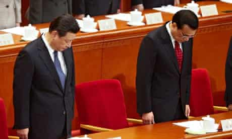 President Xi Jinping (L) and Chinese Premier Li Keqiang in minute's silence