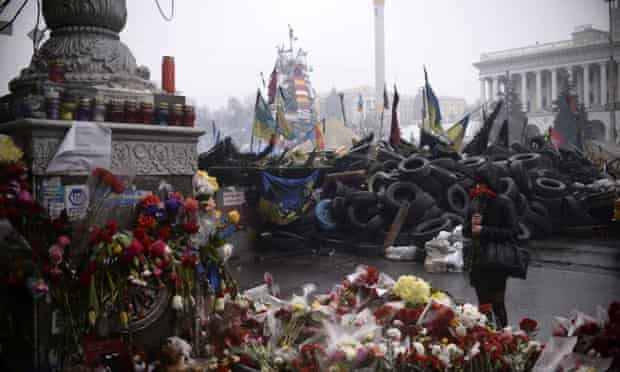 anti-government protestors and riot police at a barricade on Independence square in central Kiev on March 3, 2014.