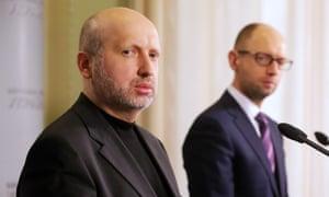 Olexander Turchynov, speaker of the parliament (L) and Ukrainian Prime Minister Arseniy Yatsenyuk hold a presser after special session of the Verkhovna Rada of Ukraine on March 2, 2014 in Kiev, Ukraine.