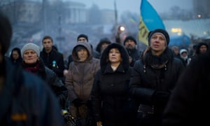People listen to  a political speech on a stage in  Kiev's Independence Square on Monday, 3 March