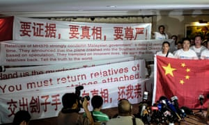 Chinese relatives of a missing Malaysian Airlines flight MH370 display banner during a meeting with media at a hotel in Subang Jaya, Selangor, Malaysia.