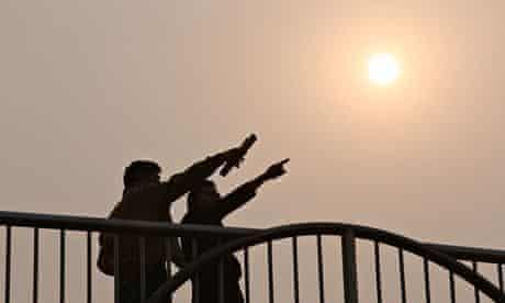 Locals in Beijing during a 'yellow' smog alert.