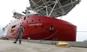 A US pinger locator is being fitted to the Australian search ship Ocean Shield in the hope of finding the black box flight recorder of MH370. The ship will not reach the search area until Thursday when signals from the missing plane's black box are expected to start to degrade.