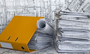 A folder and some architecture plans