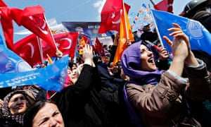Supporters of Turkish prime minister Erdogan cheer during an election rally in March 2014