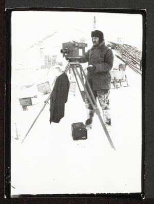 Herbert Ponting working in Antarctic conditions, Cape Evans, October 1911.