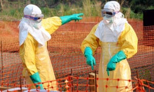 Doctors in protective gear work in the isolation ward of the southern Guinean town of Gueckedou. ebola
