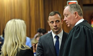 Oscar Pistorius talks with his defence team during a break in proceedings.