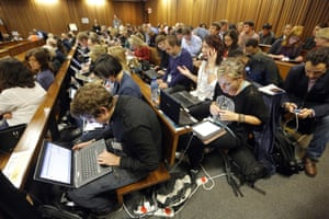 Journalists at work during a break in the Oscar Pistorius trial