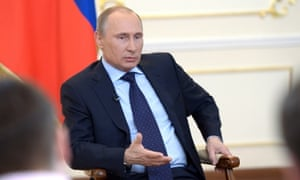 Russian president Vladimir Putin attends a news conference on the Ukraine crisis