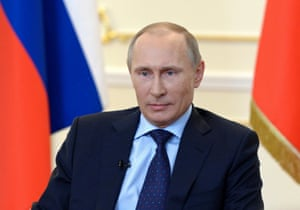 Russian President Vladimir Putin takes part in a news conference at the Novo-Ogaryovo state residence outside Moscow March 4, 2014.