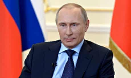 Vladimir Putin takes part in a news conference