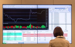 A woman looks at a screen with diagrams and tables at Moscow Interbank Currency Exchange (MICEX) on March 4, 2014. .