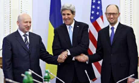 John Kerry shakes hands with Interim President Oleksandr Turchynov and Arseniy Yatsenyuk