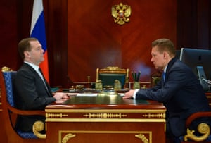 Russian Premier Dmitry Medvedev meets Russian state natural giant gas monopoly Gazprom head Alexei Miller, right, at the Gorky residence outside Moscow on Tuesday, March 4, 2014.