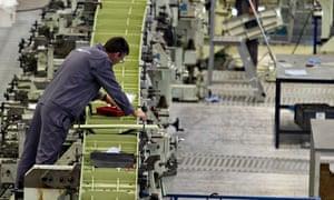 GKN employees work on the wing of an Airbus A380