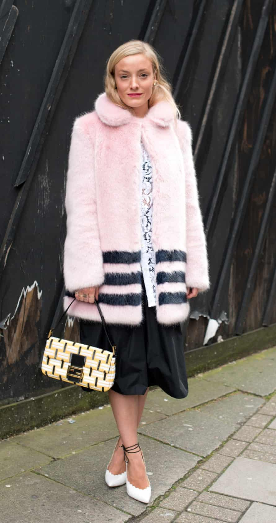 Stylist and model Kate Foley wears a Shrimps coat at London Fashion Week
