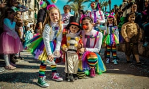 Young revellers pose for a photo during the Sunday parade of the carnival in Sitges, Spain.