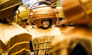 Revellers dressed as 'Golden Globes' take part at the traditional parade of Torres Vedras carnival in Portugal