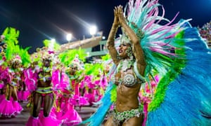 Members of Mangueira samba school celebrate during their parade at Sapucai Sambadrome  in Rio de Janeiro