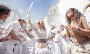 People throw talcum powder as they take part in the carnival of  Los Indianos in Santa Cruz de la Palma