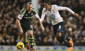 Tottenham's Paulinho, right, in action with Stoke's Charlie Adam