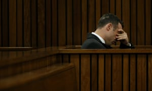 Oscar Pistorius sits alone during a break in his trial