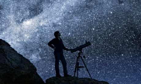 Man Stargazing in Desert