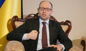 Ukrainian Prime Minister Arseniy Yatsenyuk talks with reporters during an interview with the Associated Press in Kiev, Ukraine, Wednesday 5 March, 2014.