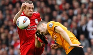 Liverpool's Charlie Adam challenges Wolverhampton Wanderers' Matt Doherty, right, during a Premier League match at Anfield