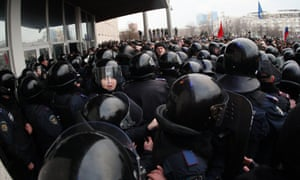Pro-Russian protesters clash with police as they attempt to storm a regional state administration building in Donetsk